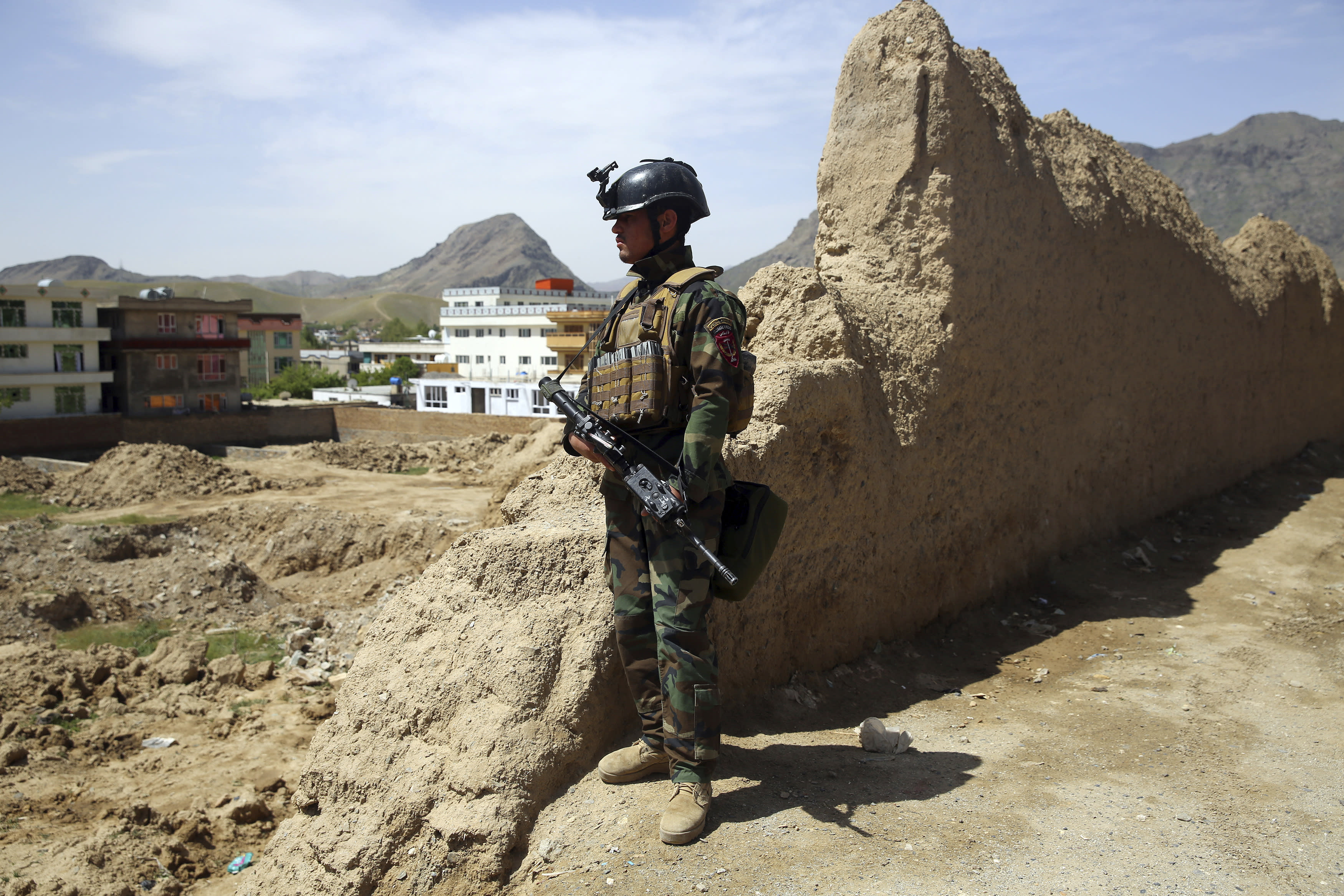 An Afghan special force member stands guard at the site of a suicide bomber attack on the outskirts of Kabul, Afghanistan, Wednesday, April 29, 2020. A suicide bomber on Wednesday targeted a base belonging to Afghan special forces on the southern outskirts of the capital, officials said. (AP Photo/Rahmat Gul)