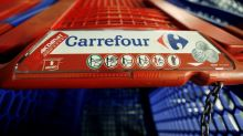 French supermarket operator Carrefour raises cost savings goal