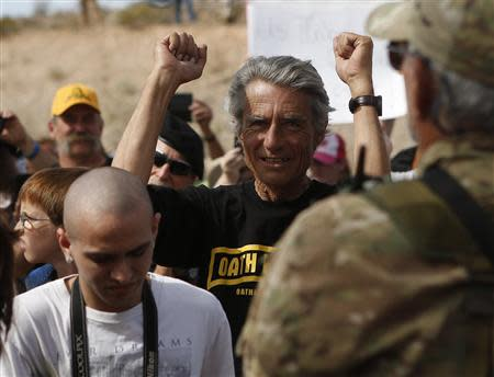 A protester reacts in Bunkerville, Nevada, April 12, 2014. Clark County Sheriff Douglas Gillespie announced the Bureau of Land Management (BLM) was ceasing its cattle roundup operation. Armed U.S. rangers had been rounding up cattle on federal land in Nevada in a rare showdown with Cliven Bundy, a rancher who has illegally grazed his herd on public lands for decades, as conflict over land use simmers in western states. REUTERS/Jim Urquhart