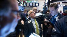 Wall Street en ordre dispersé, attentive aux développements commerciaux