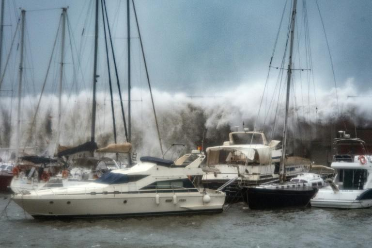 Waves broke over a sea wall at the Port Olympic marina in Barcelona as storm Gloria battered the Spanish eastern coast earlier this week (AFP Photo/Josep LAGO)