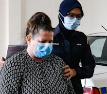 British woman who stabbed husband to death in their Malaysian home avoids hanging