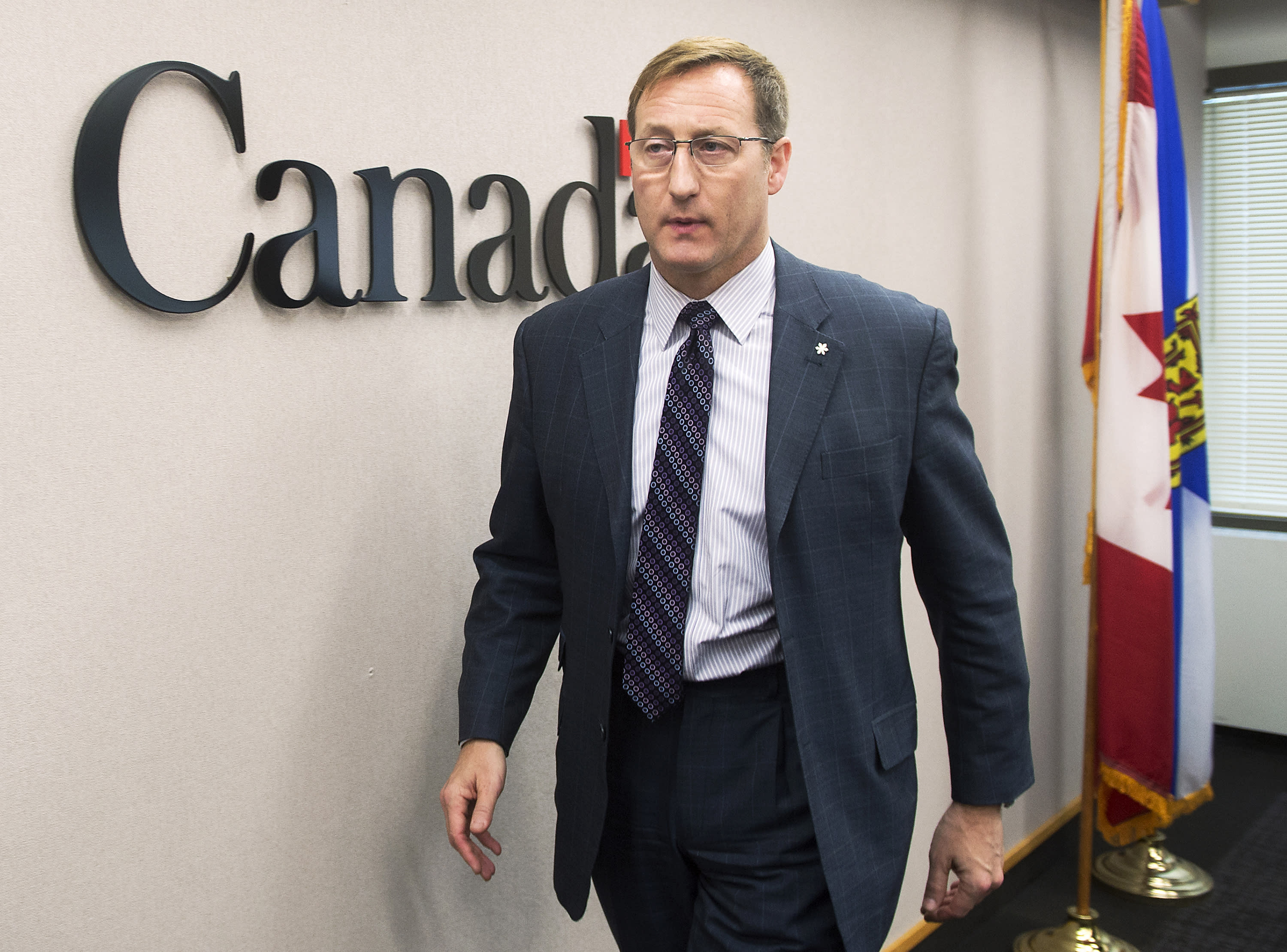 FILE - In this Feb. 14, 2015, file photo, Justice Minister Peter MacKay heads from a news conference in Halifax, Canada. Canada's opposition Conservative Party is holding an entirely mail-in ballot election for a new leader to carry it into the next general election. Results are to be announced on Sunday, Aug. 24, 2020. The frontrunners appeared to be former Cabinet minister Peter MacKay and veteran MP Erin O'Toole. (Andrew Vaughan/The Canadian Press via AP, File)
