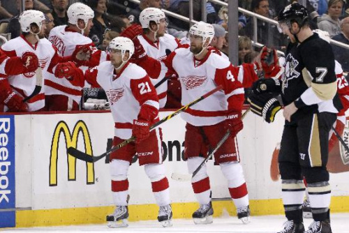 Detroit Red Wings' Jakub Kindl (4) returns to the bench after his goal in the second period of an NHL hockey game against the Pittsburgh Penguins in Pittsburgh, Wednesday, April 9, 2014