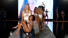 Model takes to Sports Illustrated Swimsuit catwalk in a wheelchair, absolutely kills it