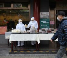 New virus cases soar in S.Korea and Chinese prisons, more die in Iran