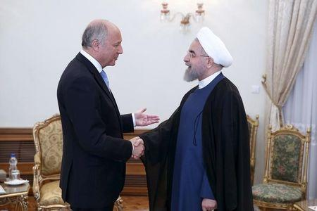 Iran's President Hassan Rouhani welcomes French foreign minister Laurent Fabius in Tehran