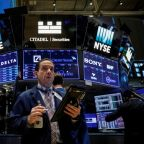 Dow ends above 23,000 for first time; IBM jumps