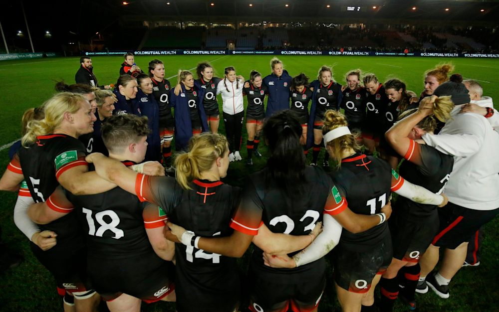 The Red Roses huddle before their second Test against Canada at Twickenham Stoop - The RFU Collection