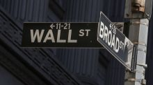 Wall Street slips, weighed down by healthcare plunge