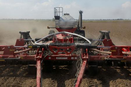 FILE PHOTO: A fertilising mechanism fertilizes soybean fields in Gideon, Missouri, U.S., May 16, 2018. REUTERS/Shannon Stapleton/File Photo