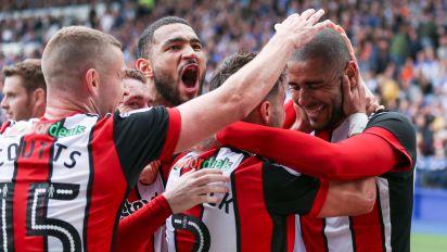 Clarke double helps Blades sink Owls in Sheffield derby