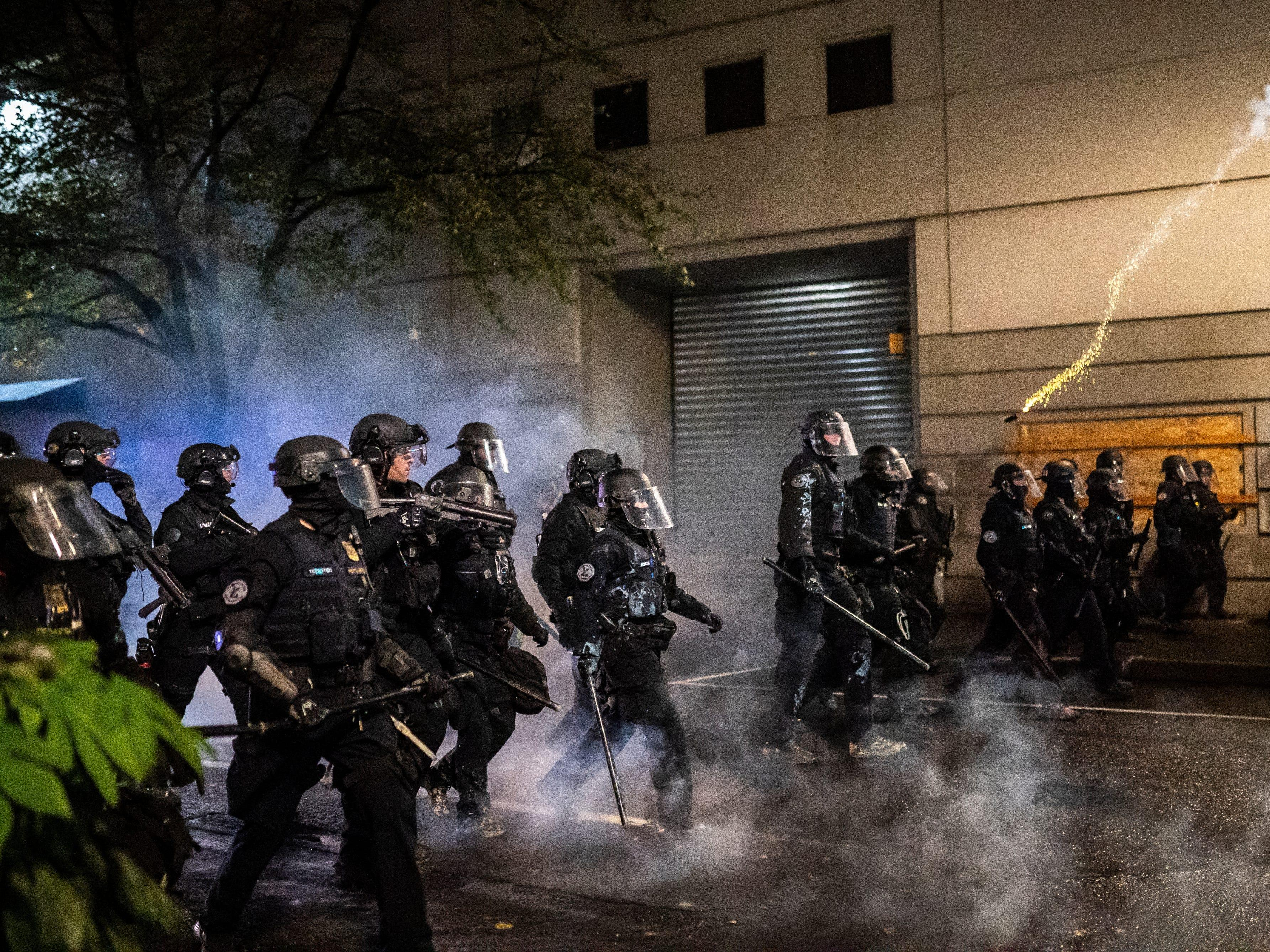 Portland police officers have quit the force's crowd-control team after one of the cops was charged with assaulting a protester