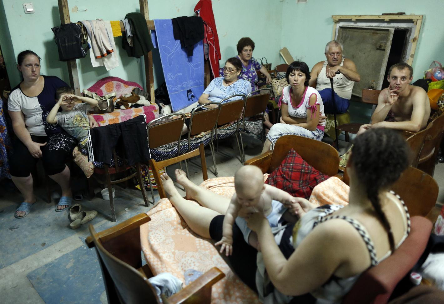 Photo taken on August 13, 2014 shows people inside a makeshift bomb shelter in the basement of their house in the town of Yasynuvata near Donetsk, eastern Ukraine (AFP Photo/Max Vetrov)