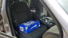 Police charge man for using case of beer in place of toddler's car seat
