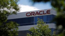 Corrected: Oracle, VMware agree to deal on cloud technology, technical support