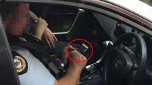 Officer slammed over incriminating photo behind wheel