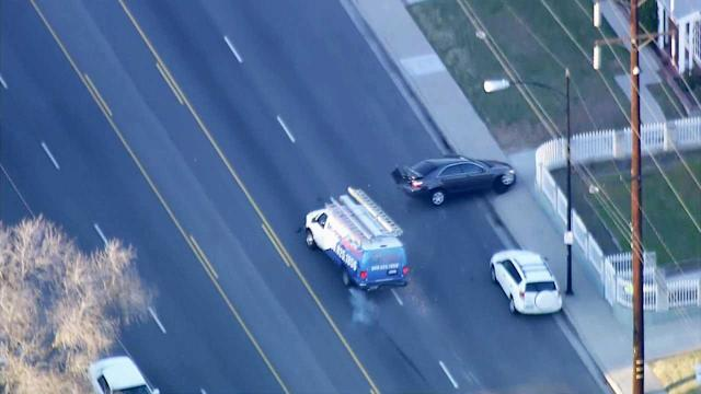 Pursuit suspect crashes into car in traffic