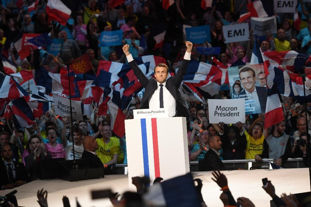 """Emmanuel Macron told crowds in Paris his presidency would bring """"hope and courage"""" (AFP Photo/Eric FEFERBERG)"""