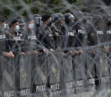 Thai pro-democracy protesters rally outside army base