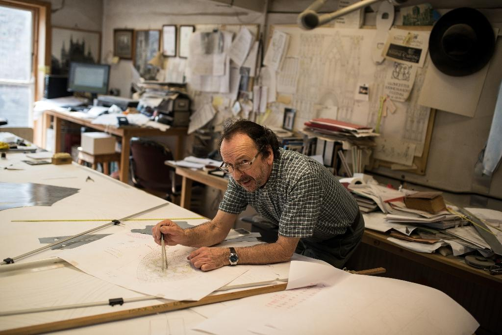 York Minster's Master stonemason John David believes Notre-Dame in Paris can be fixed but it may take time (AFP Photo/OLI SCARFF)