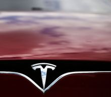 Tesla's stock soars to 4th-straight record as Wall Street's biggest bear raises price target