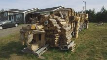Pennfield woodpile sculptor creates biggest stack ever