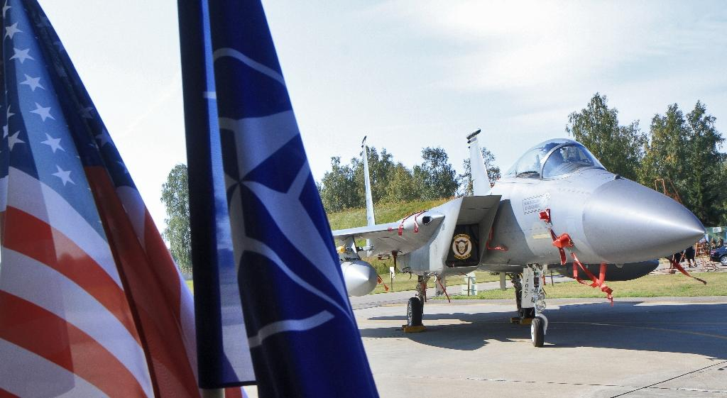 Baltic state leaders will ask the United States to send more troops and bolster air defences on NATO's eastern flank to deter Russia when they meet President Donald Trump on Tuesday (AFP Photo/Petras Malukas)