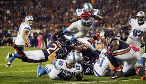Cutler shakes off injury, Bears beat Lions 13-7