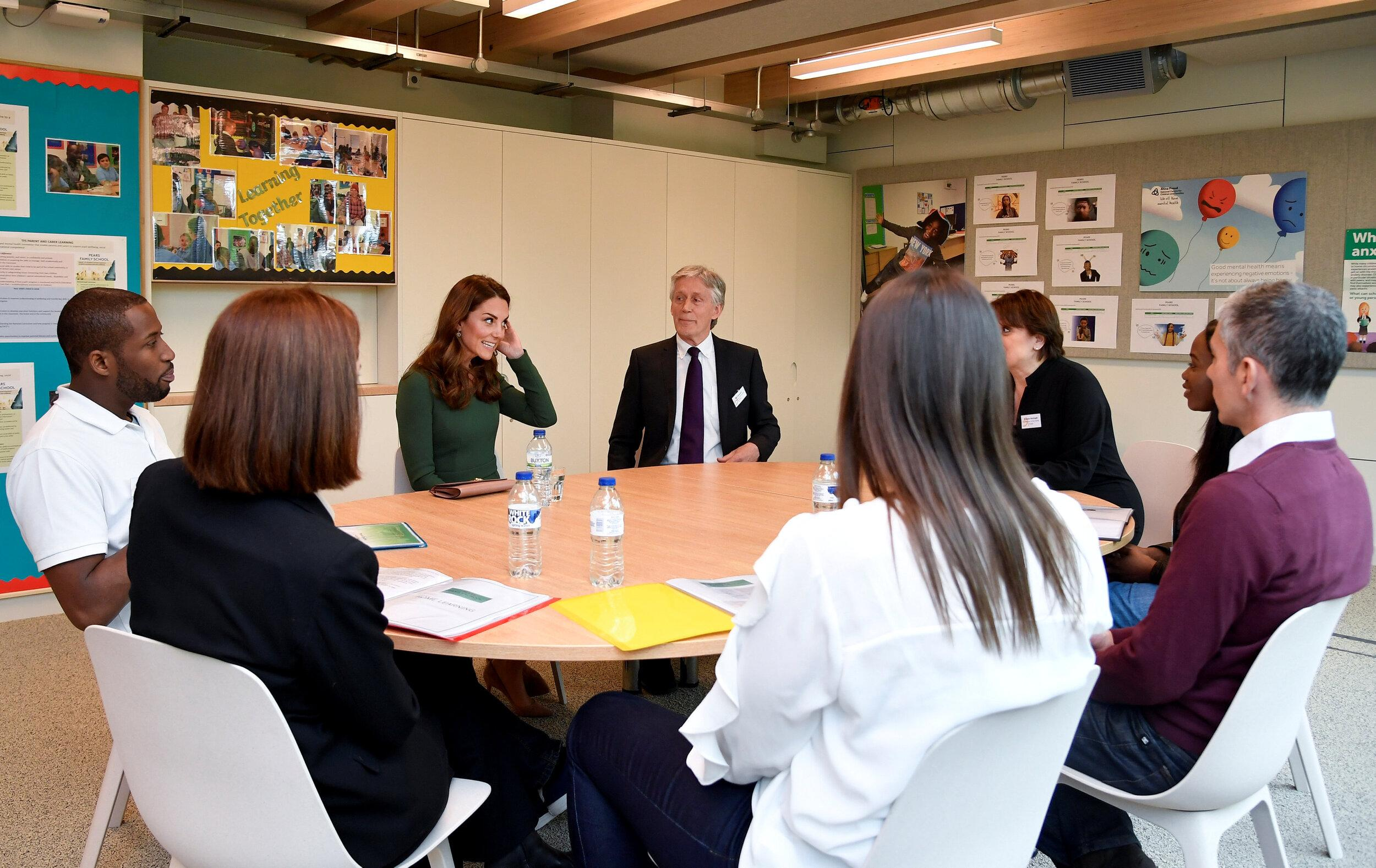 Britain's Catherine, Duchess of Cambridge speaks with users of the Anna Freud National Centre for Children and Families during her visit in London on May 1, 2019. (Photo by TOBY MELVILLE / POOL / AFP)        (Photo credit should read TOBY MELVILLE/AFP/Getty Images)
