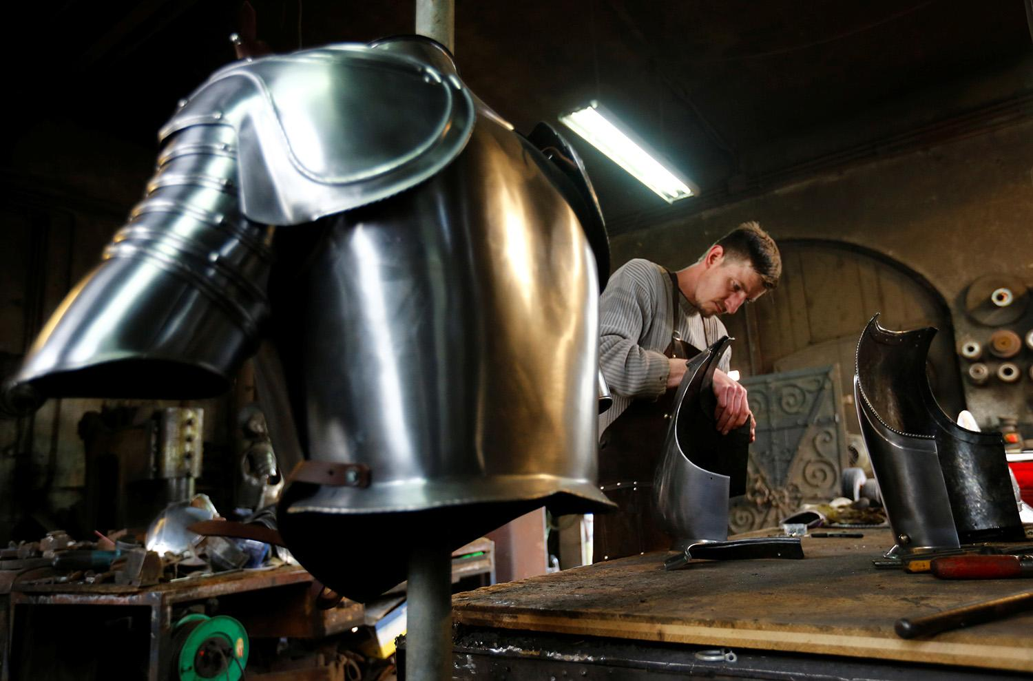 <p>Blacksmith Johann Schmidberger works on a suit of armor for the Vatican's Swiss Guards at his workshop in Molln, Austria, March 29, 2017. (Photo: Leonhard Foeger/Reuters) </p>