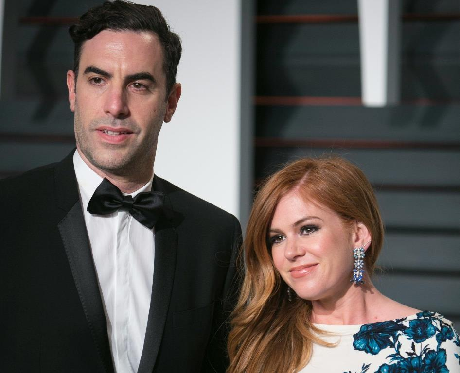 Sacha Baron Cohen (L) and his wife Isla Fisher (R) are donating $1 million (900,000 euros) to help Syrian refugees, the charities receiving the money have said (AFP Photo/)