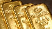 Gold eases, but holds near seven-year peak as virus impact weighs