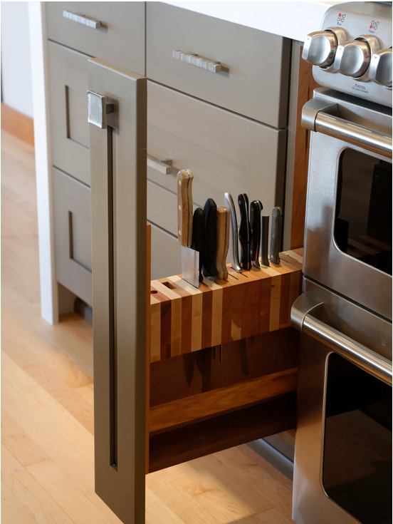 <p>This secret, slide-out knife rack keeps your sharps safely stashed away. Also, it just looks <i>awesome</i>. (Photo: Houzz)</p>