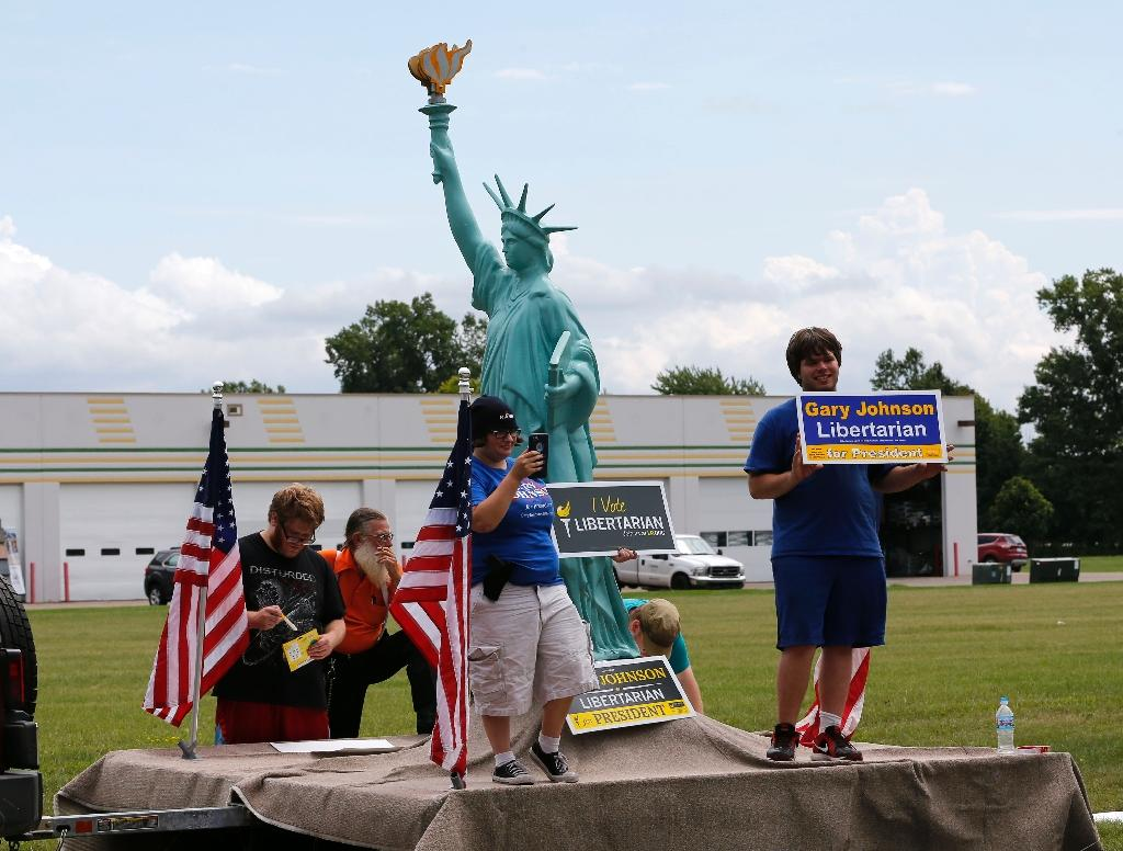 Supporters of Libertarian third-party candidate Gary Johnson gather outside a rally for US Republican presidential candidate Donald Trump at the Summit Sports and Ice Complex on August 19, 2016 (AFP Photo/Jeff Kowalsky)