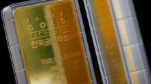 Gold firms on dollar slide, U.S. stimulus hopes
