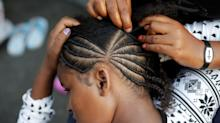 School Suspends Racist Hair Policy, Bowing to Protests