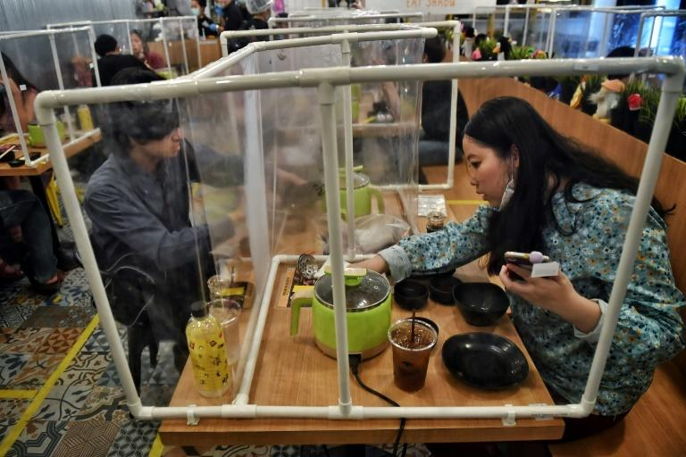 Restrictions on Bangkok's restaurants were eased Sunday allowing customers to eat-in with social distancing (AFP Photo/Lillian SUWANRUMPHA)