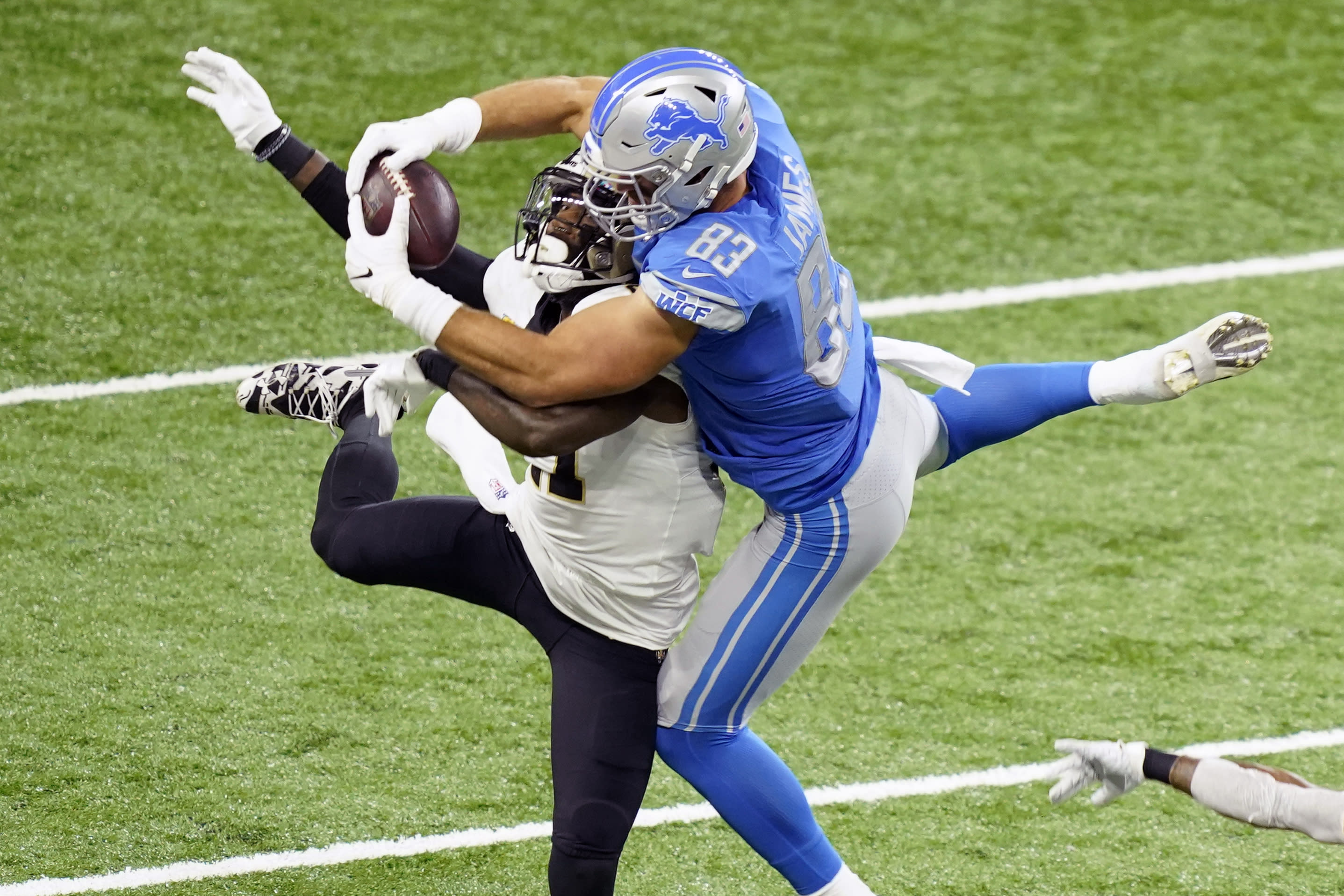 Detroit Lions tight end Jesse James (83), defended by New Orleans Saints strong safety Malcolm Jenkins (27) makes a 31-yard reception during the first half of an NFL football game, Sunday, Oct. 4, 2020, in Detroit. (AP Photo/Carlos Osorio)