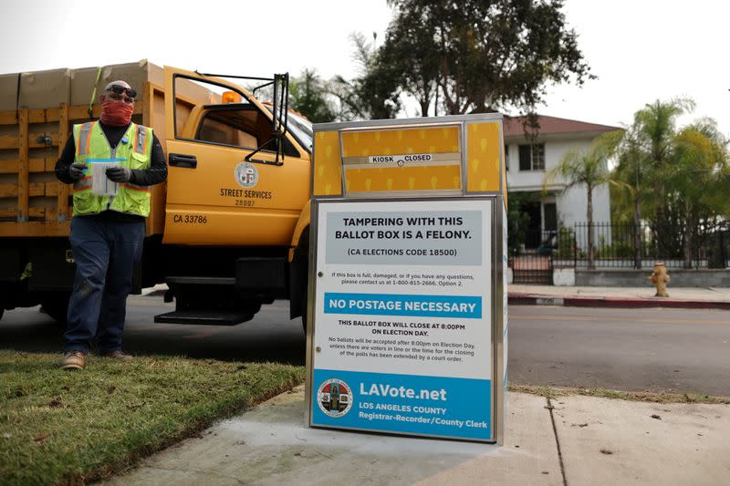 FILE PHOTO: StreetsLA workers install one of 123 Vote by Mail Drop Boxes outside a public library, amid the global outbreak of the coronavirus disease (COVID-19), in Los Angeles
