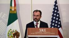 Mexico vows to impose tariffs if Trump presses wall payment