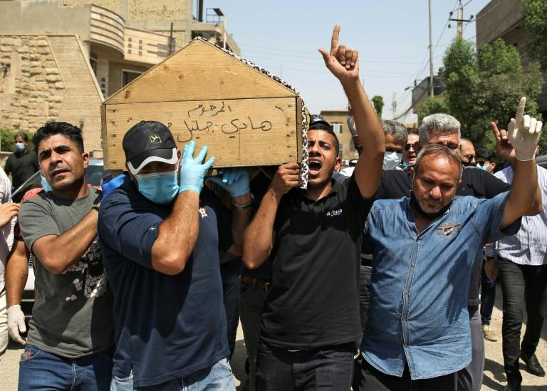 Mourners carry the coffin of Iraqi jihadism expert Hisham al-Hashemi, who was shot dead outside his house in the Iraqi capital (AFP Photo/AHMAD AL-RUBAYE)