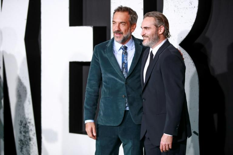"Todd Phillips (left) and Joaquin Phoenix attend the premiere of ""Joker,"" which scooped 11 Oscar nominations (AFP Photo/Rich Fury)"