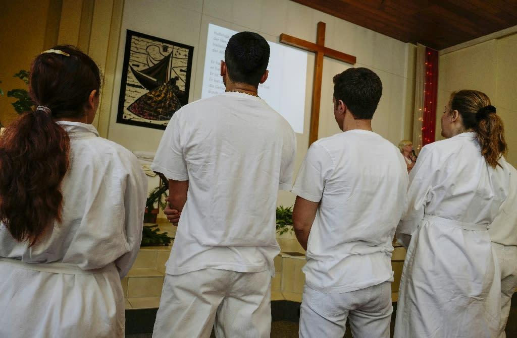 Newly-converted Muslim refugees attend a Baptism ceremony at the Evangelisch-Freikirchliche Gemeinde church in Berlin (AFP Photo/John MACDOUGALL)