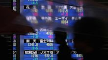 Japanese stocks rise as dollar climbs against the yen after Abe election win