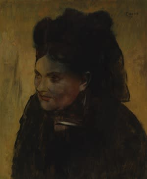 "Edgar Degas' ""Portrait of a Woman"" was painted over top of an earlier, upside-down portrait on the same canvas. By 1922, parts of the original painting were visible as a discoloration across the"