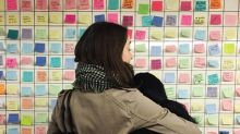 New Yorkers blanket subway walls with Post-it notes of hope