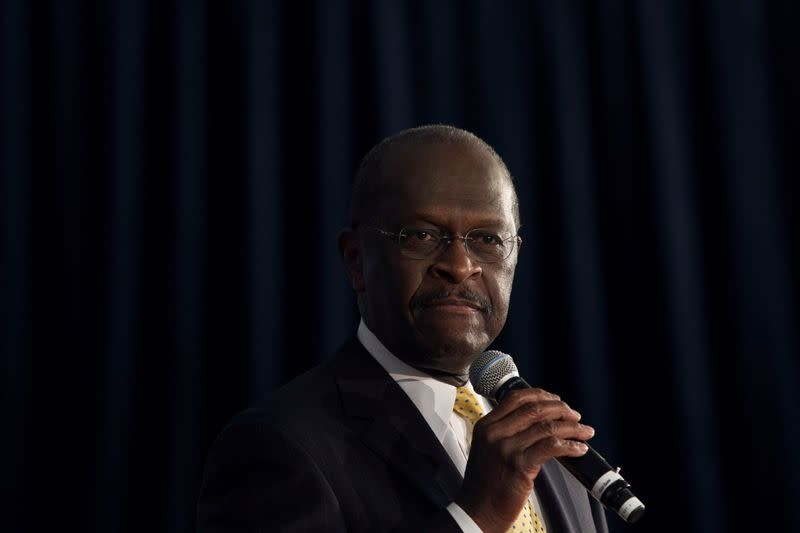 FILE PHOTO: U.S. Republican presidential candidate Herman Cain speaks at a town hall event in Rock Hill, South Carolina
