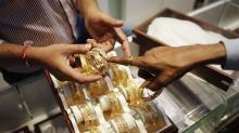 Gold steady as investors turn cautious ahead of French polls