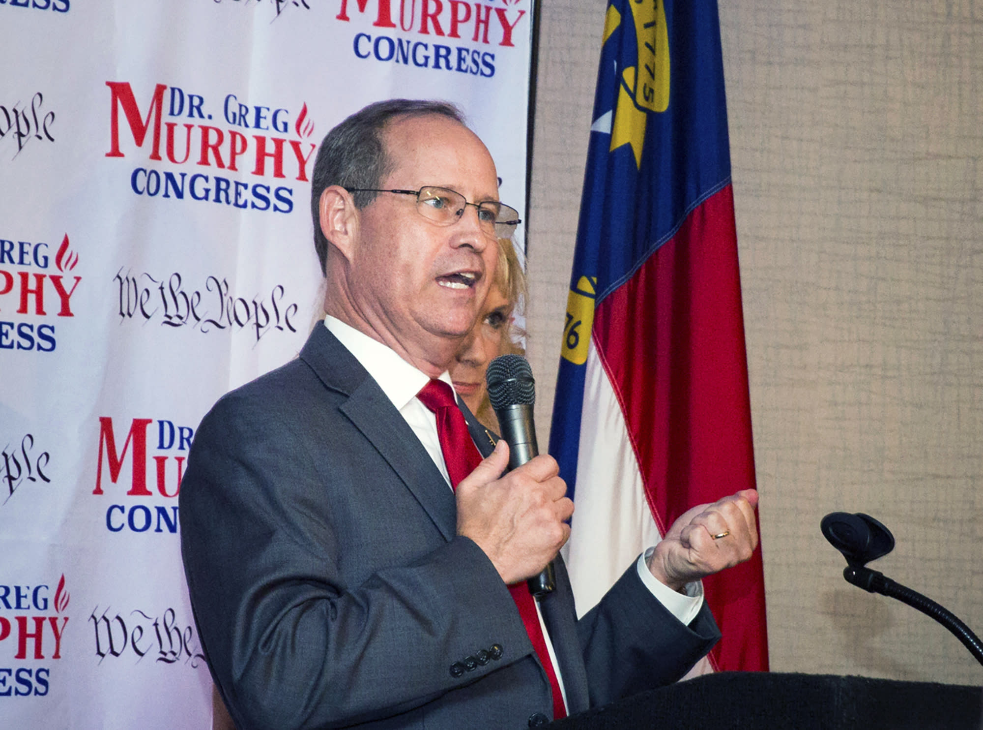 FILE - In this Tuesday, July 9, 2019 file photo, Greg Murphy speaks after he was announced the winner of the Republican nomination in North Carolina's 3rd Congressional District at Greenville Convention Center in Greenville, N.C. Voters on Tuesday decide the successor to the late Rep. Walter Jones Jr. in the 3rd Congressional District. But residents were likely thinking more about weather than elections Thursday, Sept. 5, 2019 as Dorian approached with high winds and heavy rains. Early in-person voting in the district has been cut short due to the storm. (Molly Urbina/The Daily Reflector via AP, File)